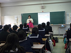 Describing the culture of her country to high school students!